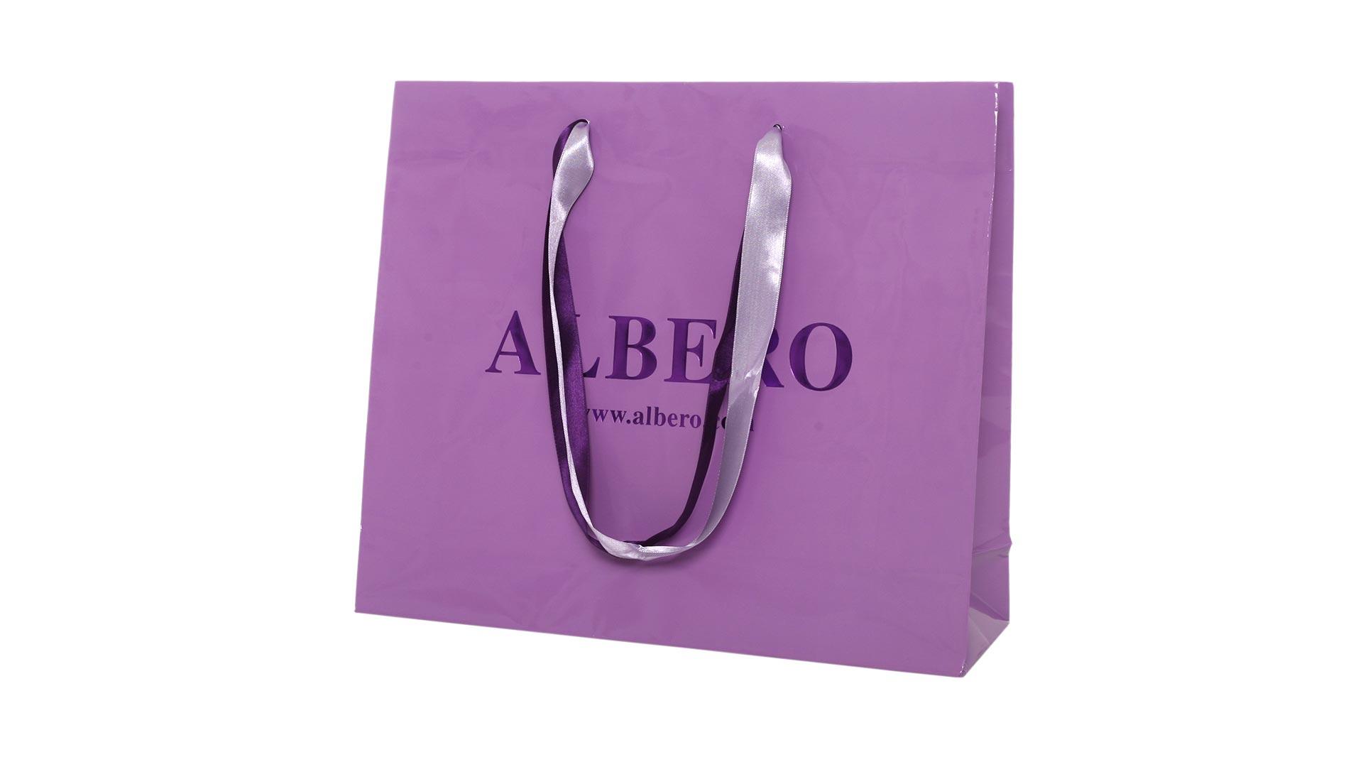 borsetta in carta viola con logo
