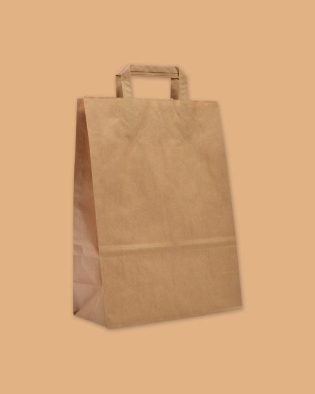 borsetta in carta grezza su sfondo giallo scuro